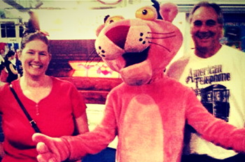 2013 Improveit Sweepstakes winners posing with the Owens Corning Pink Panter at the Ohio State Fair